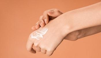 Applying mosquito repellent cream on hand is easy