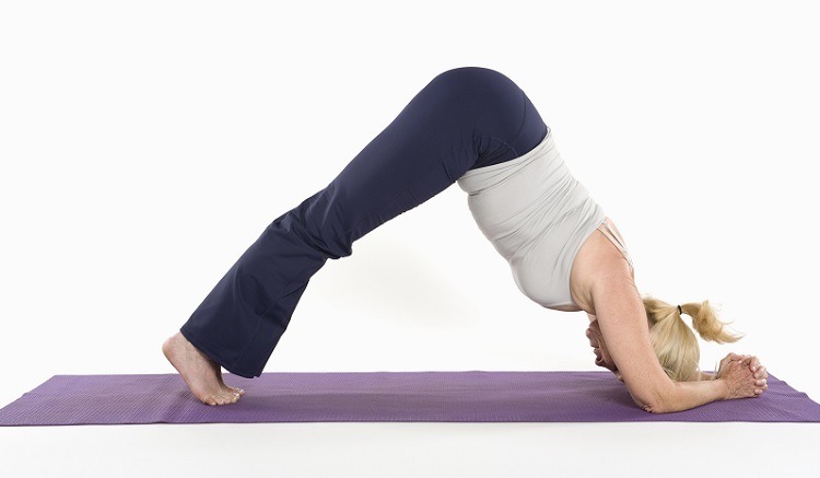 Girl Doing Yoga Using the Best Yoga Towel
