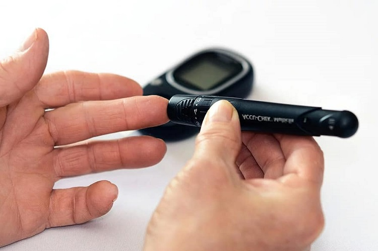 Man checking blood sugar using glucometer