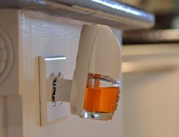 Plug-in room freshener