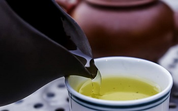 Sencha Green Tea being Poured in Cup
