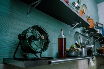 Table Fan being used in kitchen to beat the heat