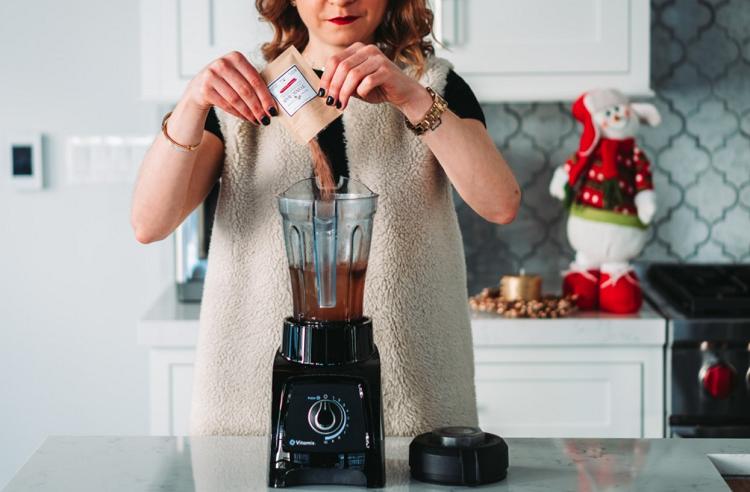 Women Using Bullet Blender to Make Smoothie