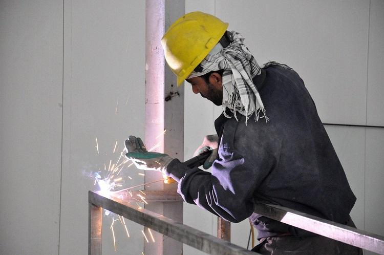 Worker Using Welding Machine