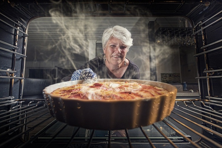 woman baking in OTG oven